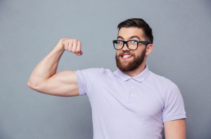 Funny man in glasses showing his muscles