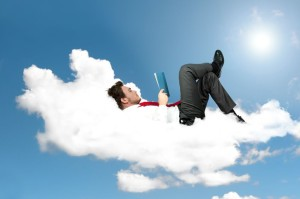 13422894 - businessman is reading a book on a cloud